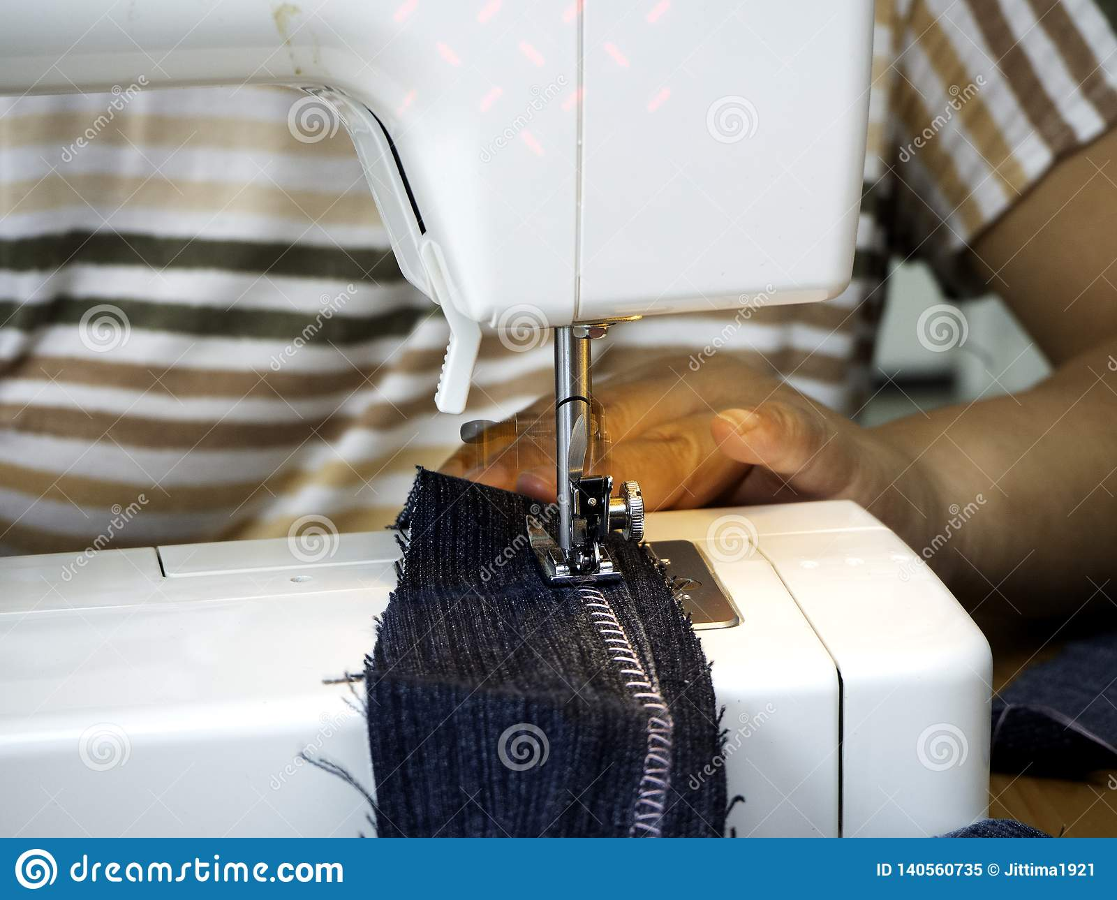 Hands working on the sewing machine