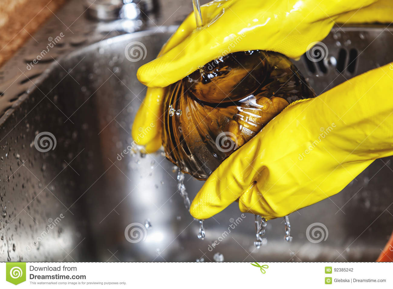 Hands In Yellow Rubber Gloves Wash Spoon Glass Bowl Stock