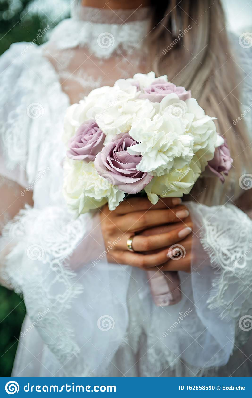 Hands Of Young Bride Holding Beautiful Wedding Bouquet. Bride`s ...