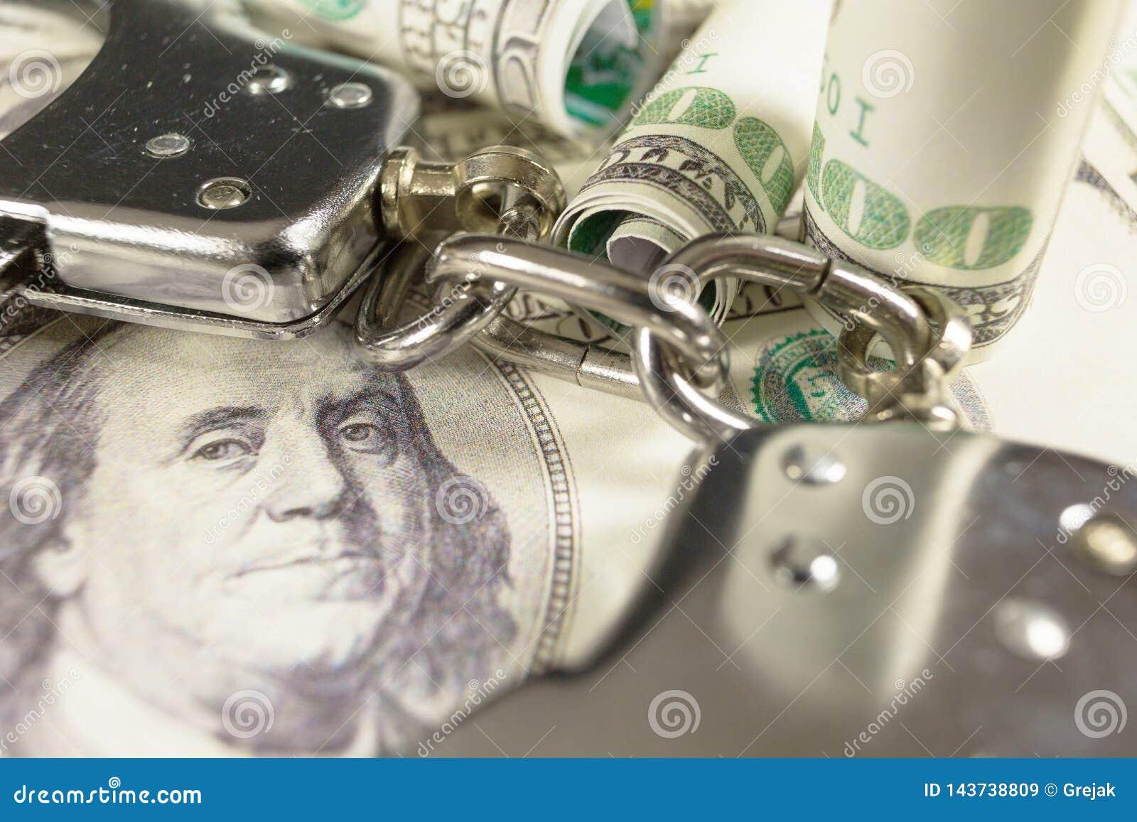 Handschellen auf Dollarscheinen