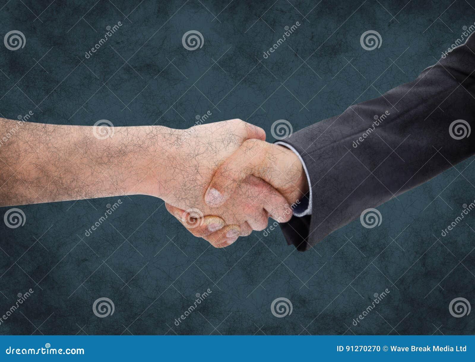 Handshake against dark blue grunge background