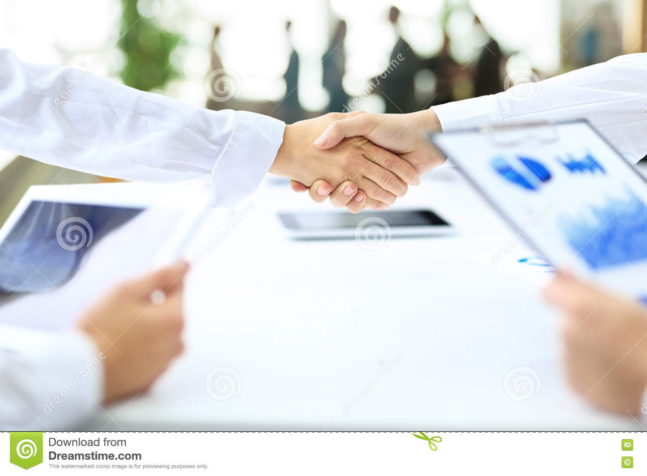 Handshake business partners after the conclusion of successful c