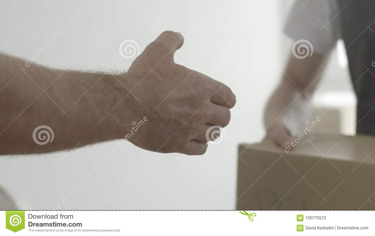 Handshake. Man thanked the worker for the work done