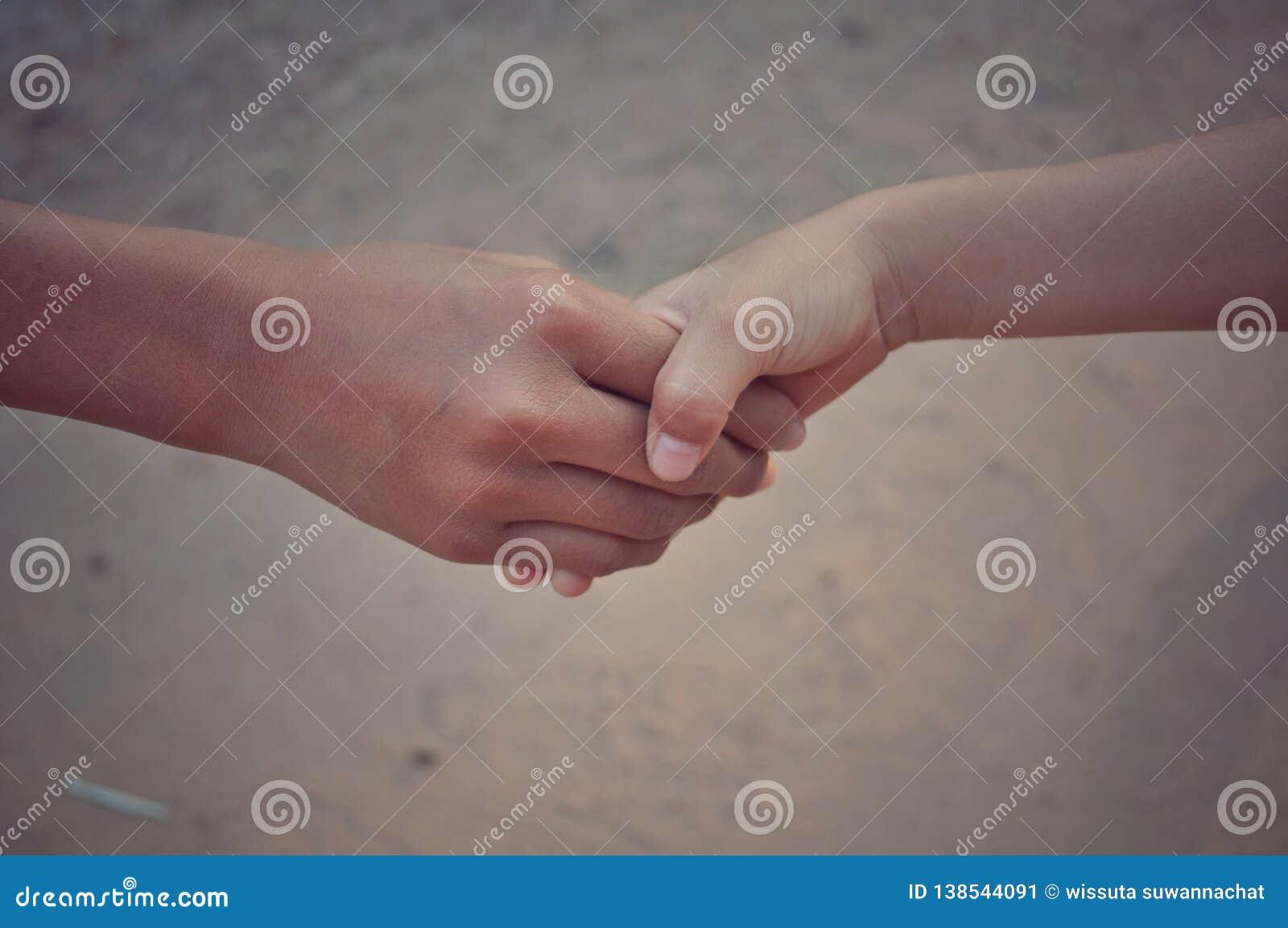 Handshake between two hands
