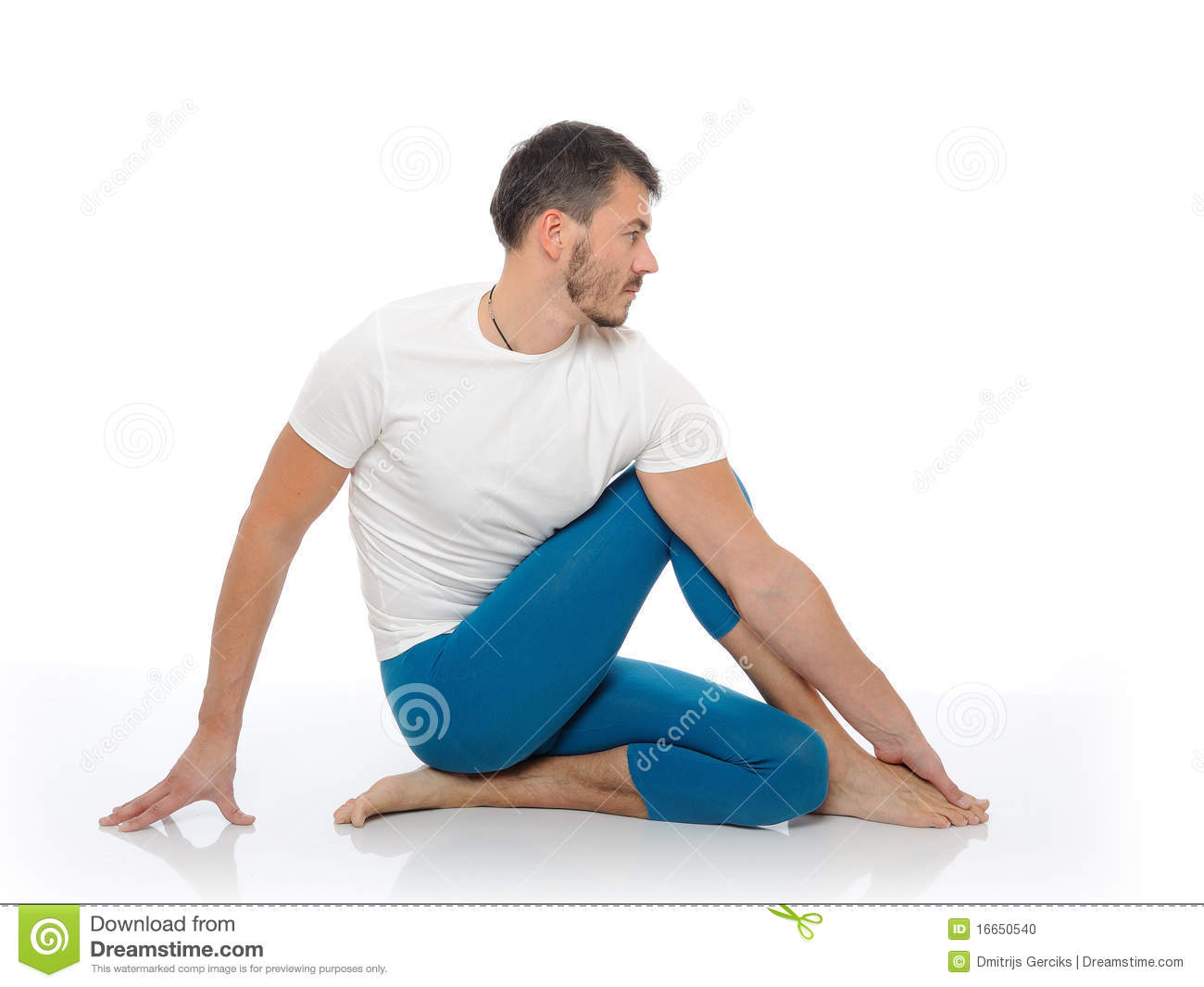Handsome Active Man Doing Yoga Fitness Poses Stock Photo