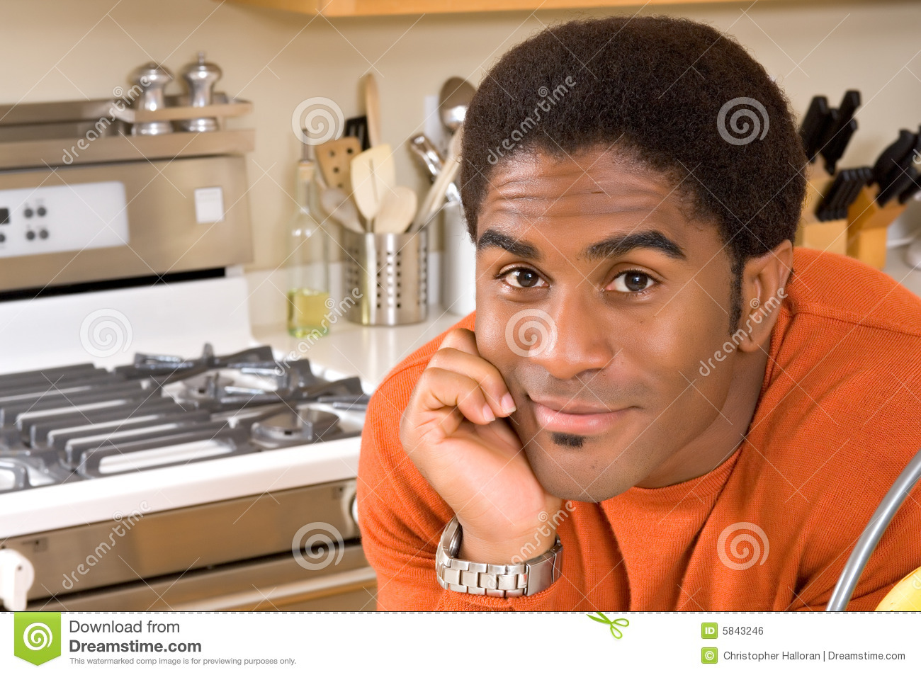 Handsome African-American man in kitchen