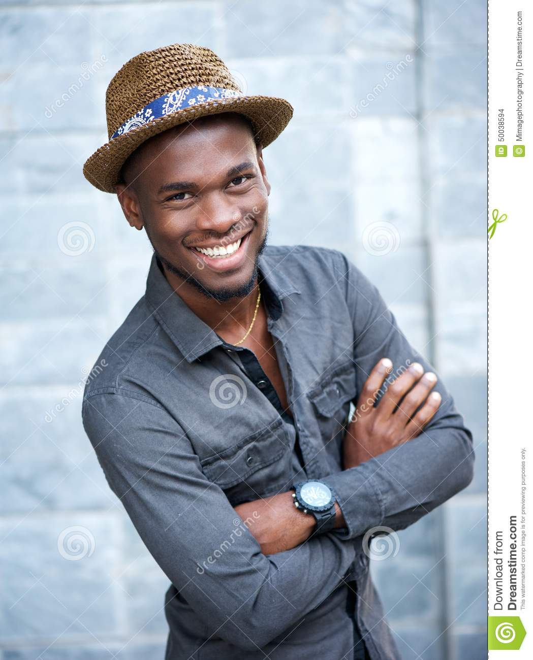 African American: Handsome African American Man Smiling With Arms Crossed