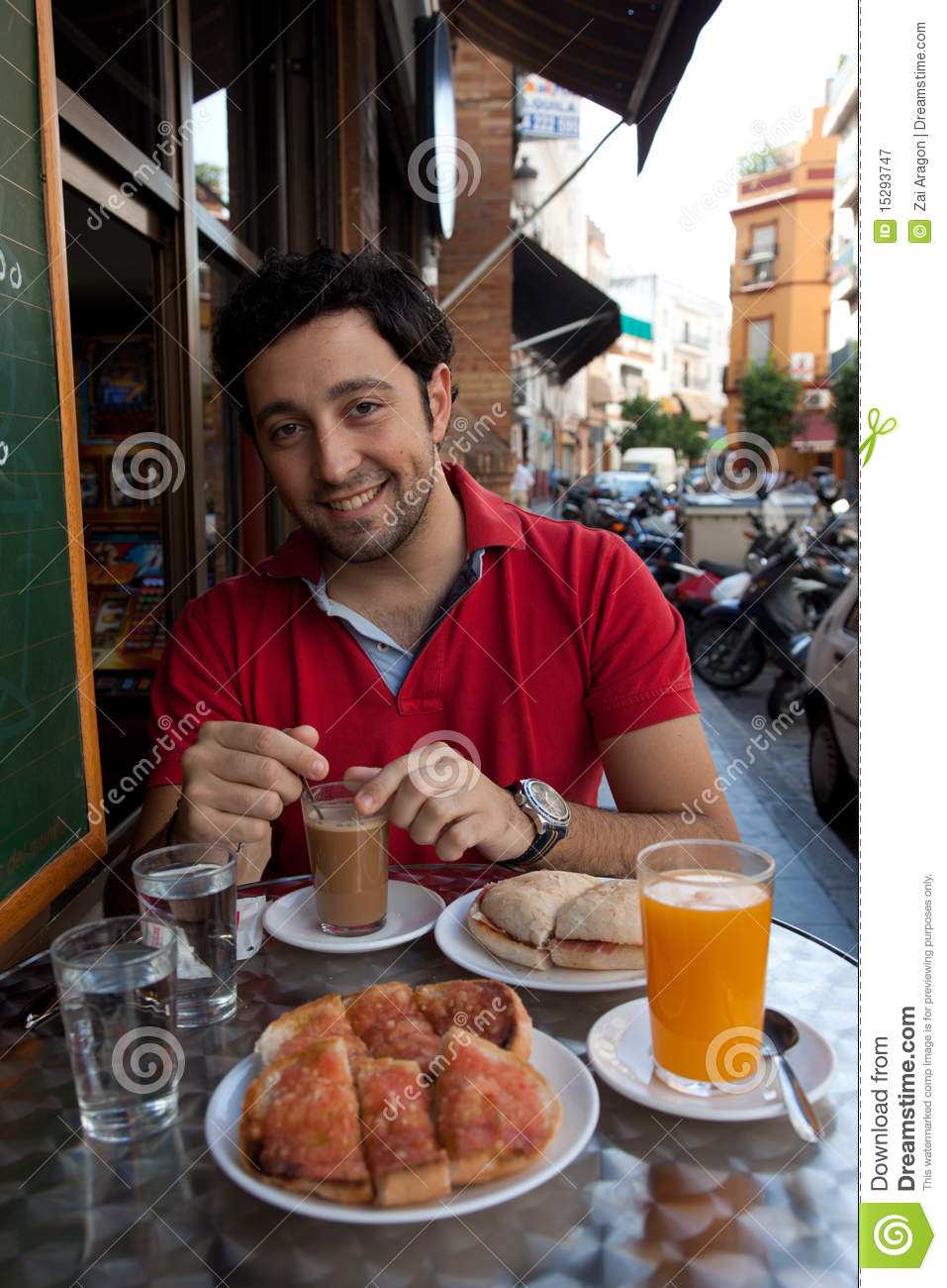 Handsome Andalusian young man having breakfast