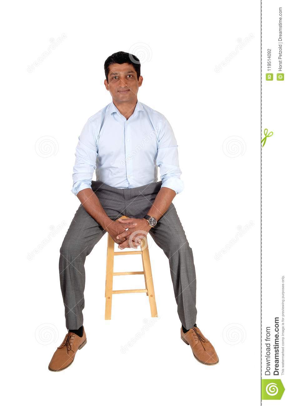 A good looking East Indian man in a suit pants and light blue shirt sitting on a bar chair isolated for white background  sc 1 st  Dreamstime.com & Handsome Asian Man Sitting On Chair Stock Photo - Image of forties ...