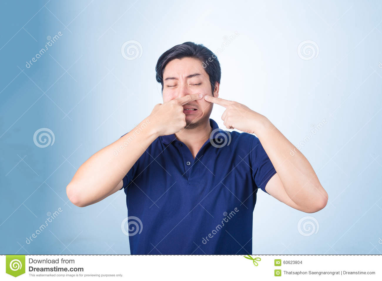 Handsome Asian man Squeezing pimple, acne,