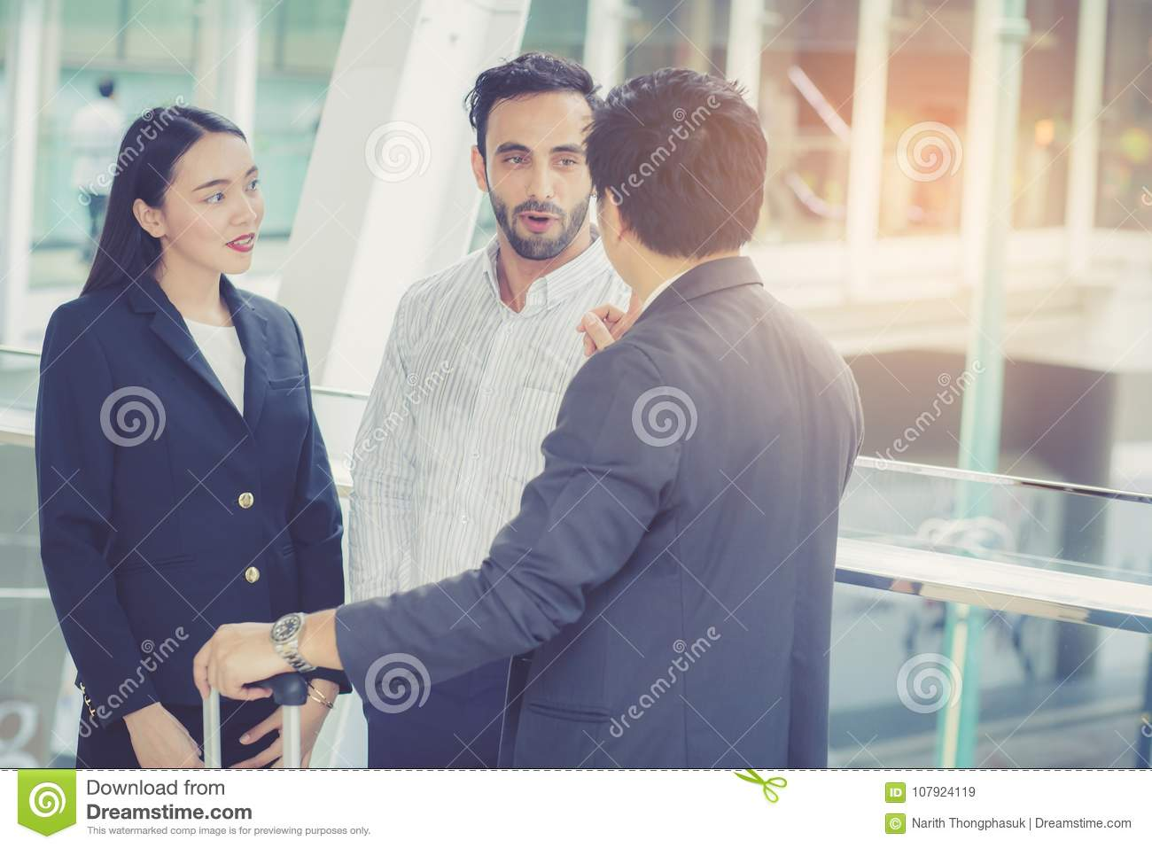 Handsome asian young businessman and businesswoman three people talking and smile