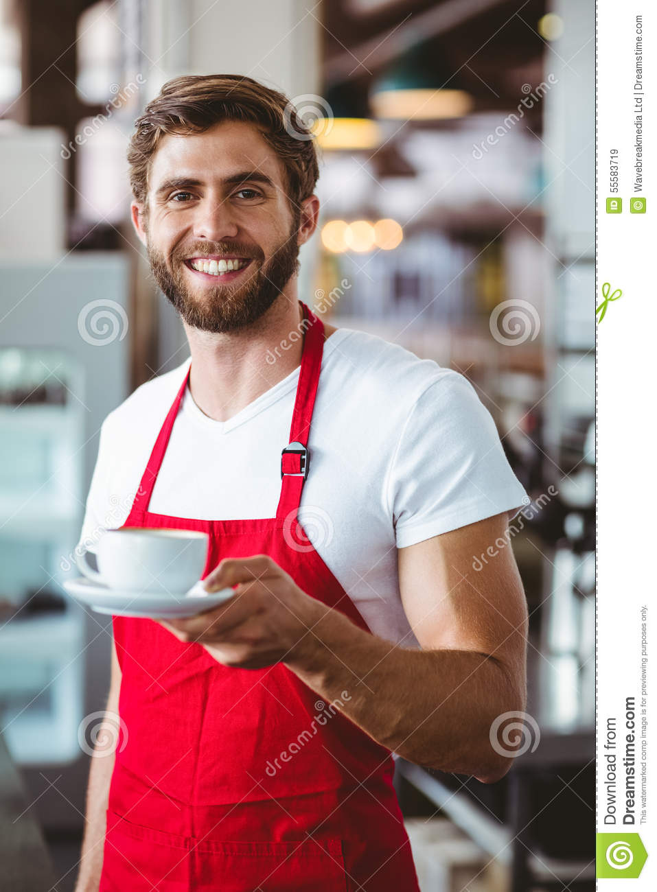 Handsome Barista Holding A Cup Of Coffee Royalty Free