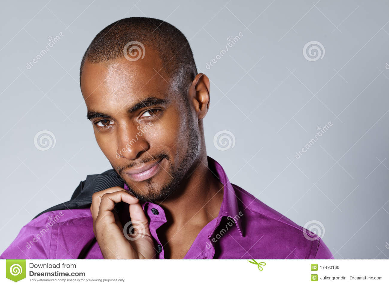Portrait of handsome smiling black man with shirt and jacket over ...