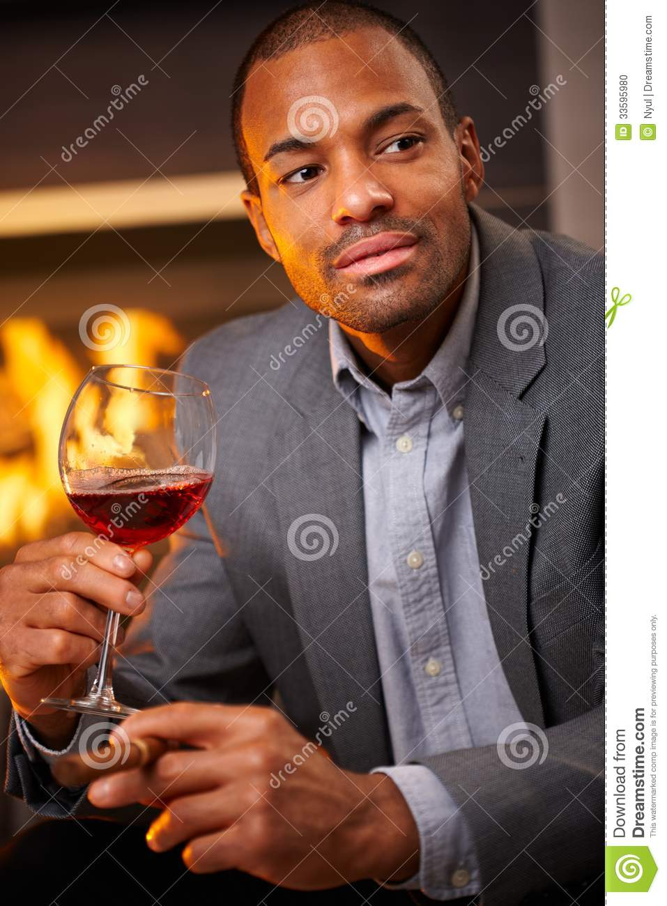Handsome Black Man With Cigar And A Glass Of Wine Stock