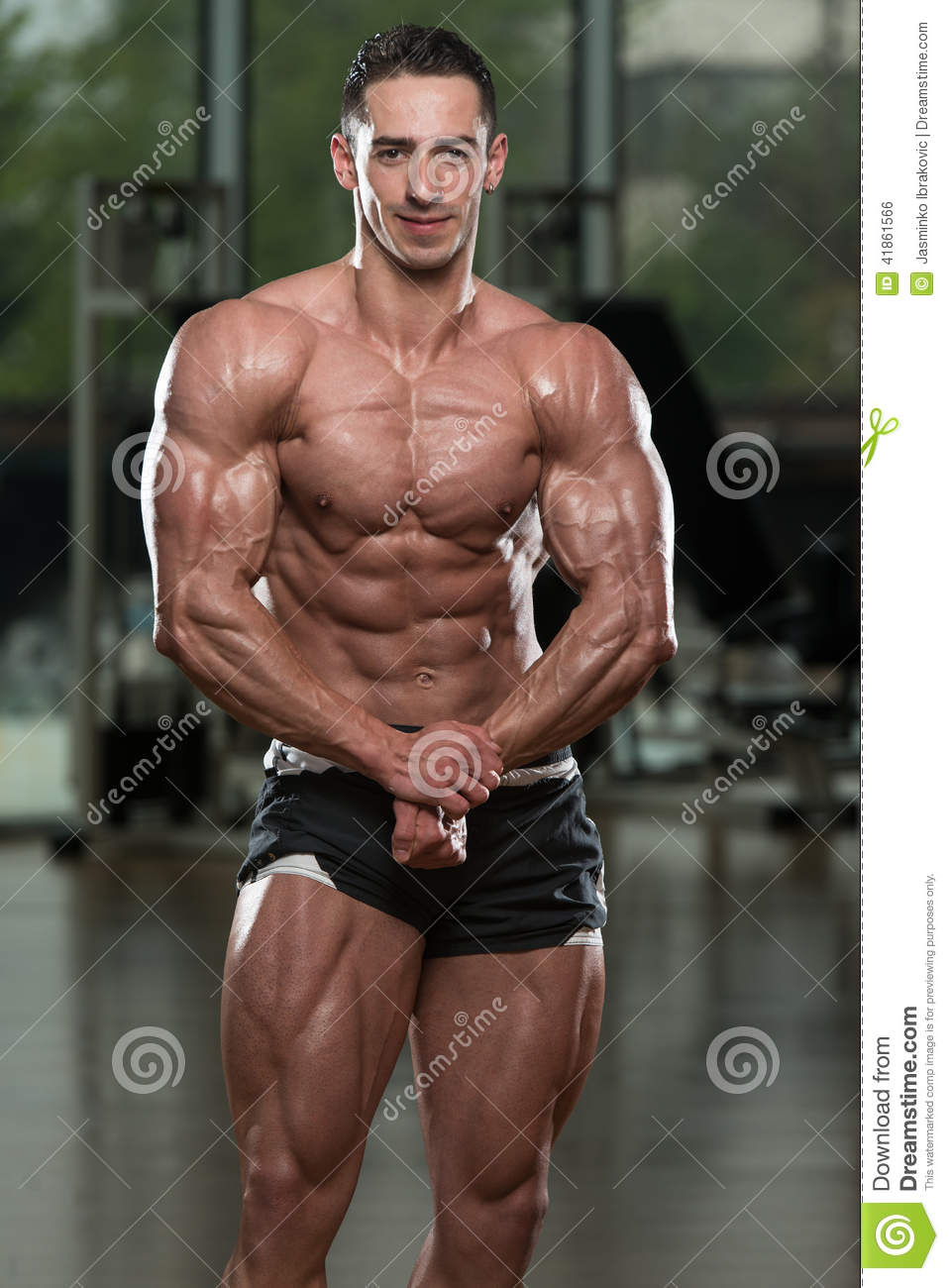 Handsome Body Builder Making Most Muscular Pose Stock