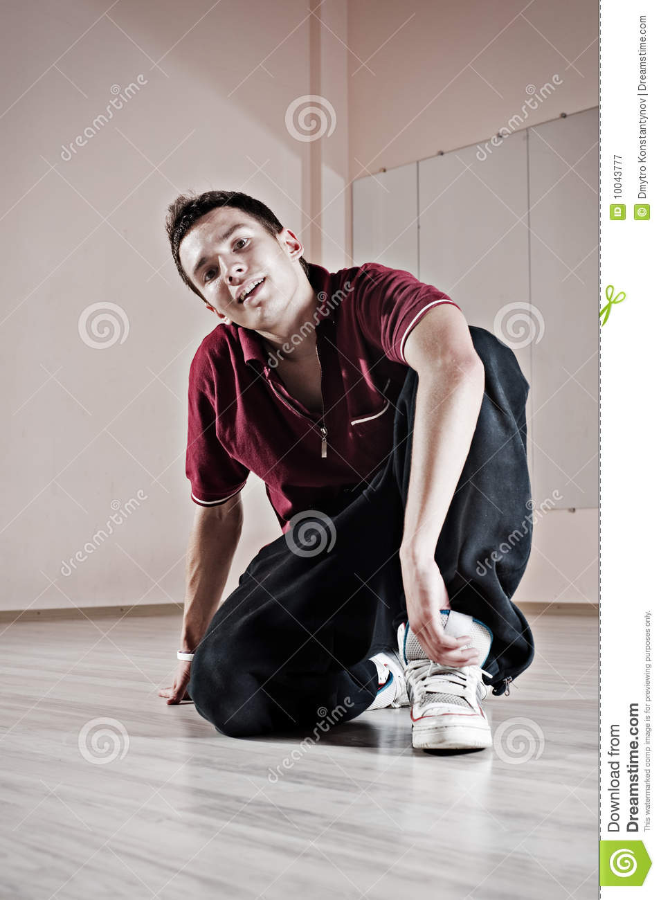 Handsome breakdancer sitting on the floor royalty free for Dance where you sit on the floor