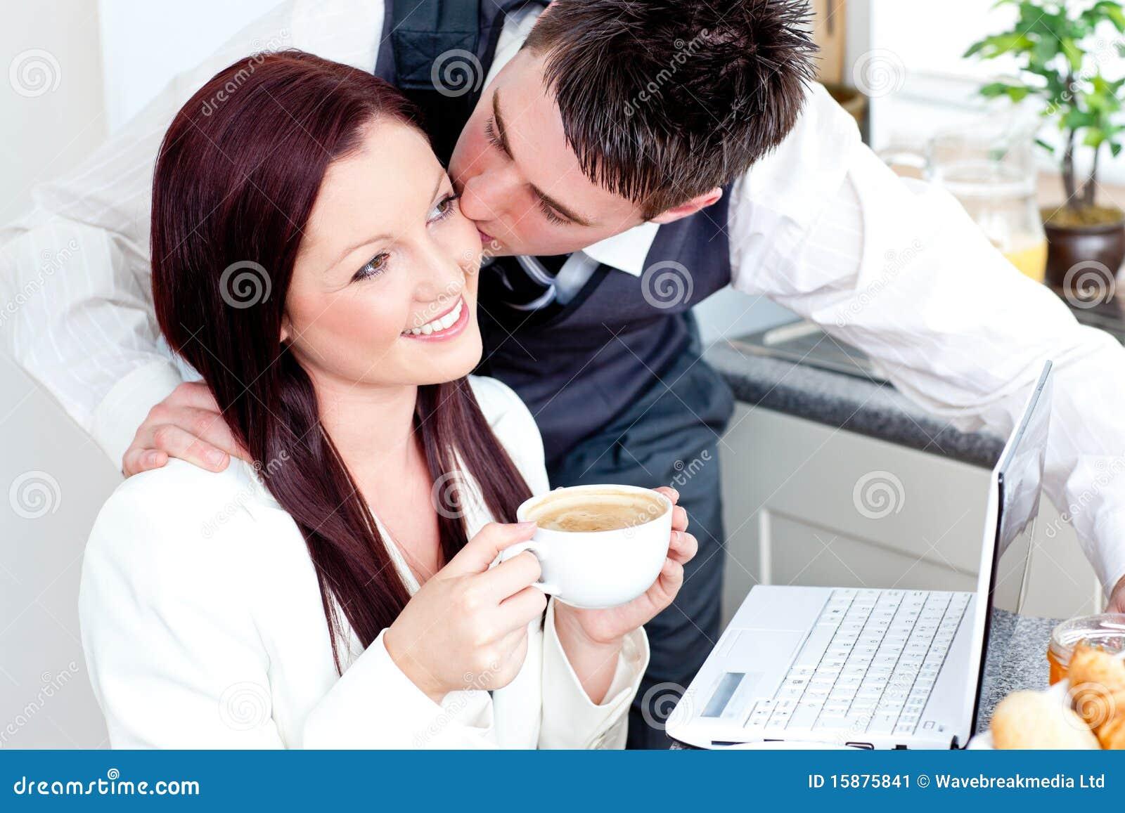 Handsome businessman kissing his bright girlfriend