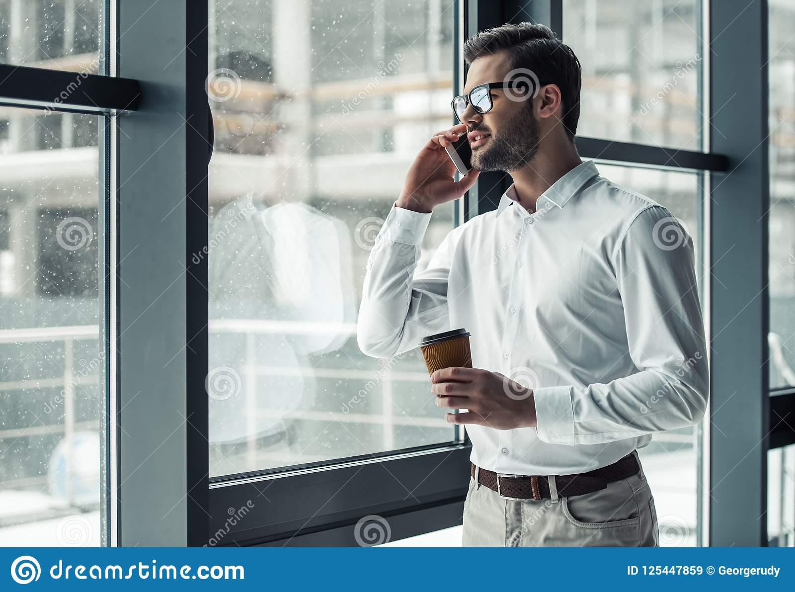 Download Handsome Businessman In Office Stock Image - Image of male, person: 125447859