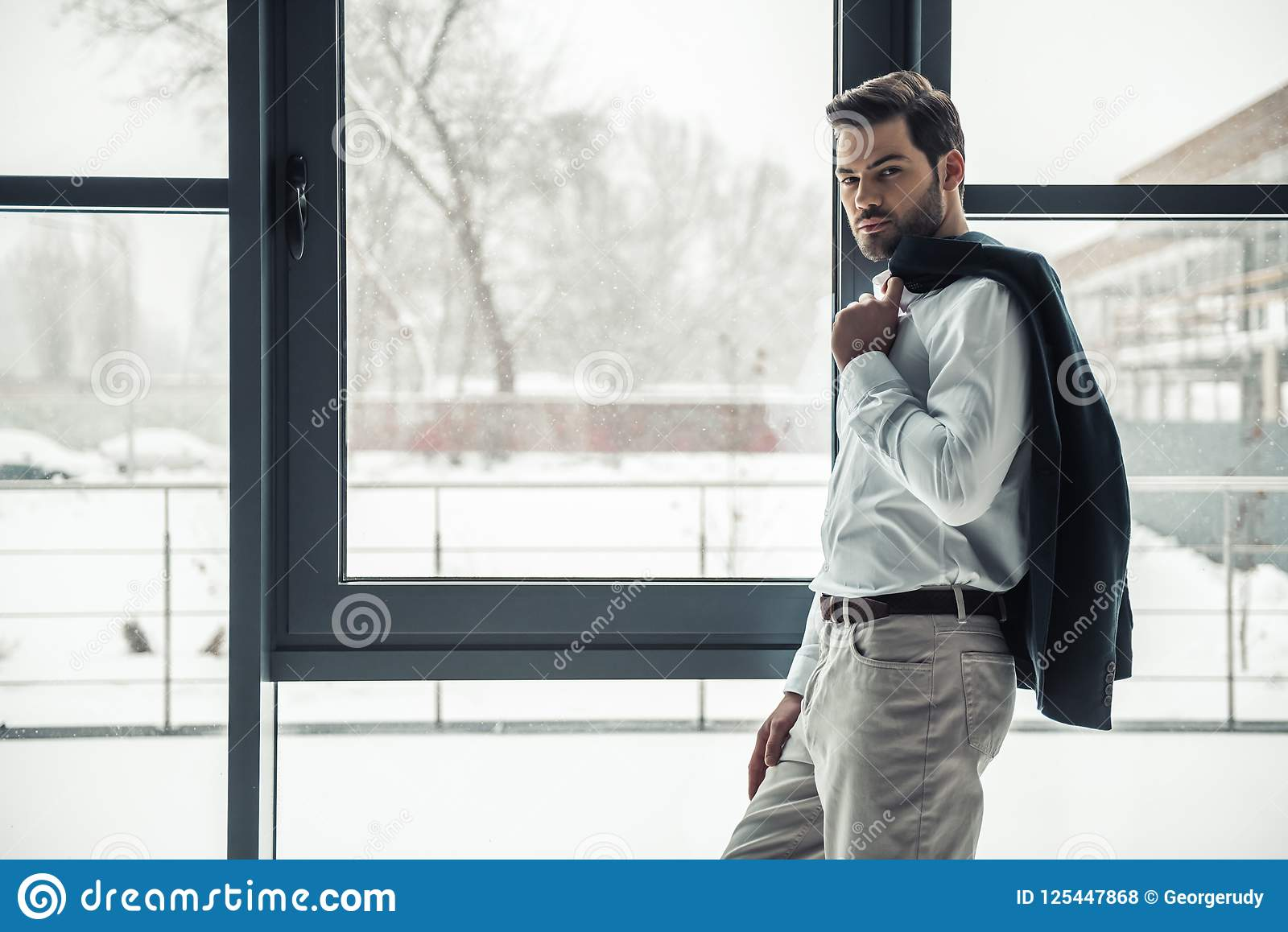 Download Handsome Businessman In Office Stock Photo - Image of break, lifestyle: 125447868