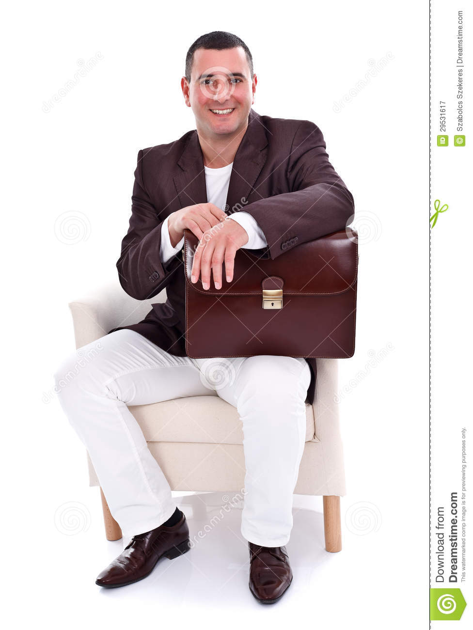 Handsome businessman sitting in armchair royalty free for Sitting in armchair