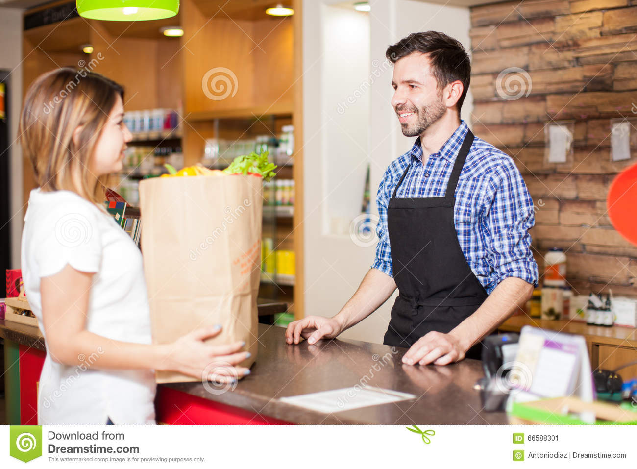 handsome cashier helping out a customer stock photo image 66588301