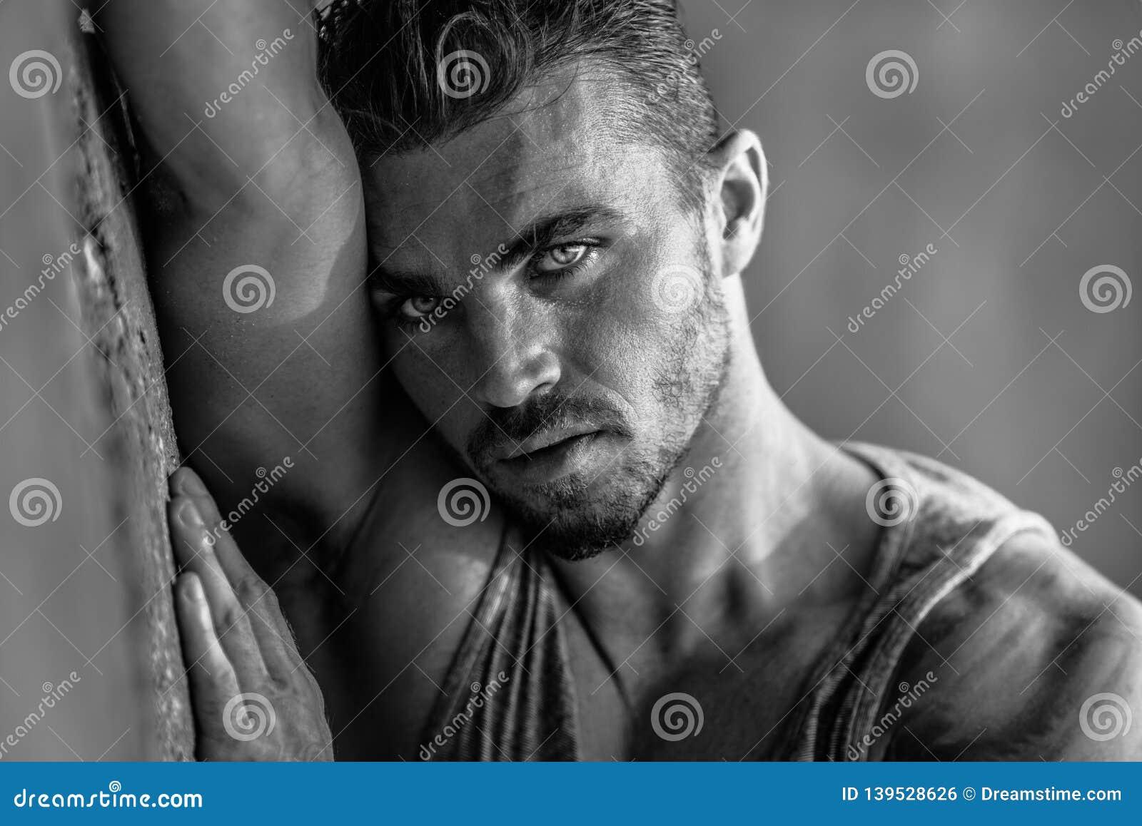 Handsome caucasian male model posing in black and white portrait