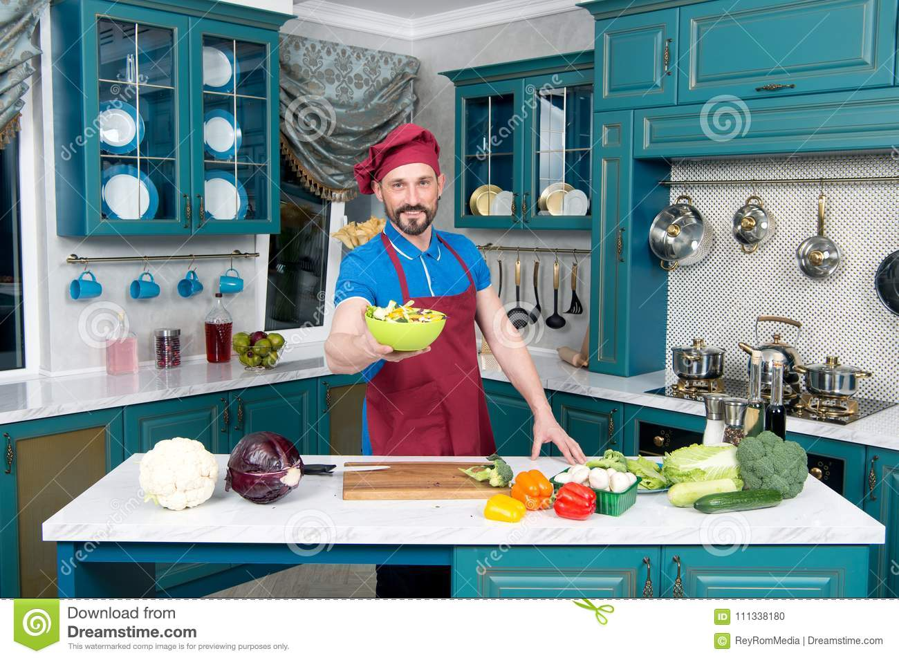 Handsome Chef In Hat Loves Cooking. Guy In Blue Polo And Apron ...