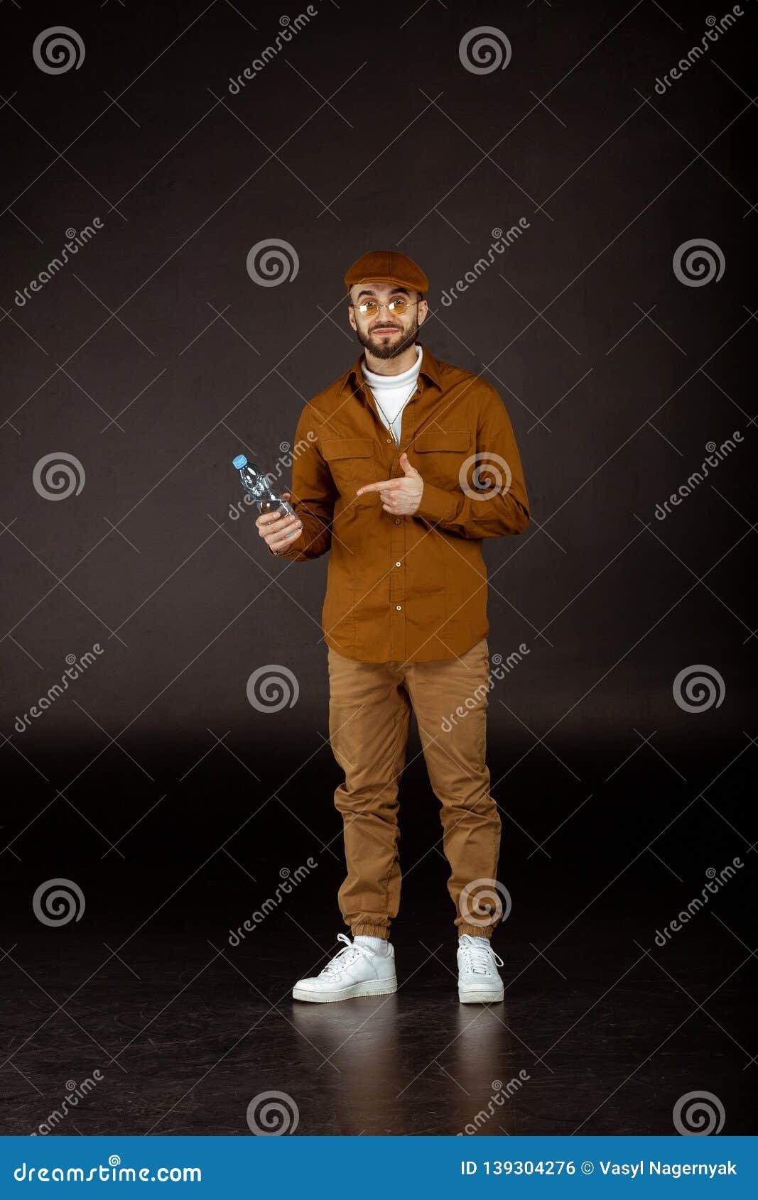 Handsome confident male model in yellowe sunglasses