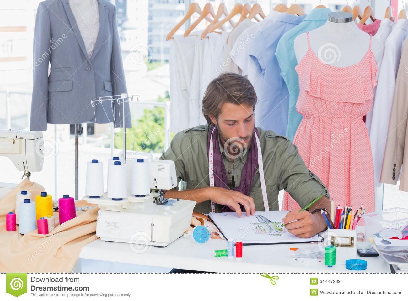 Handsome Fashion Designer Drawing With Pencils Stock Image