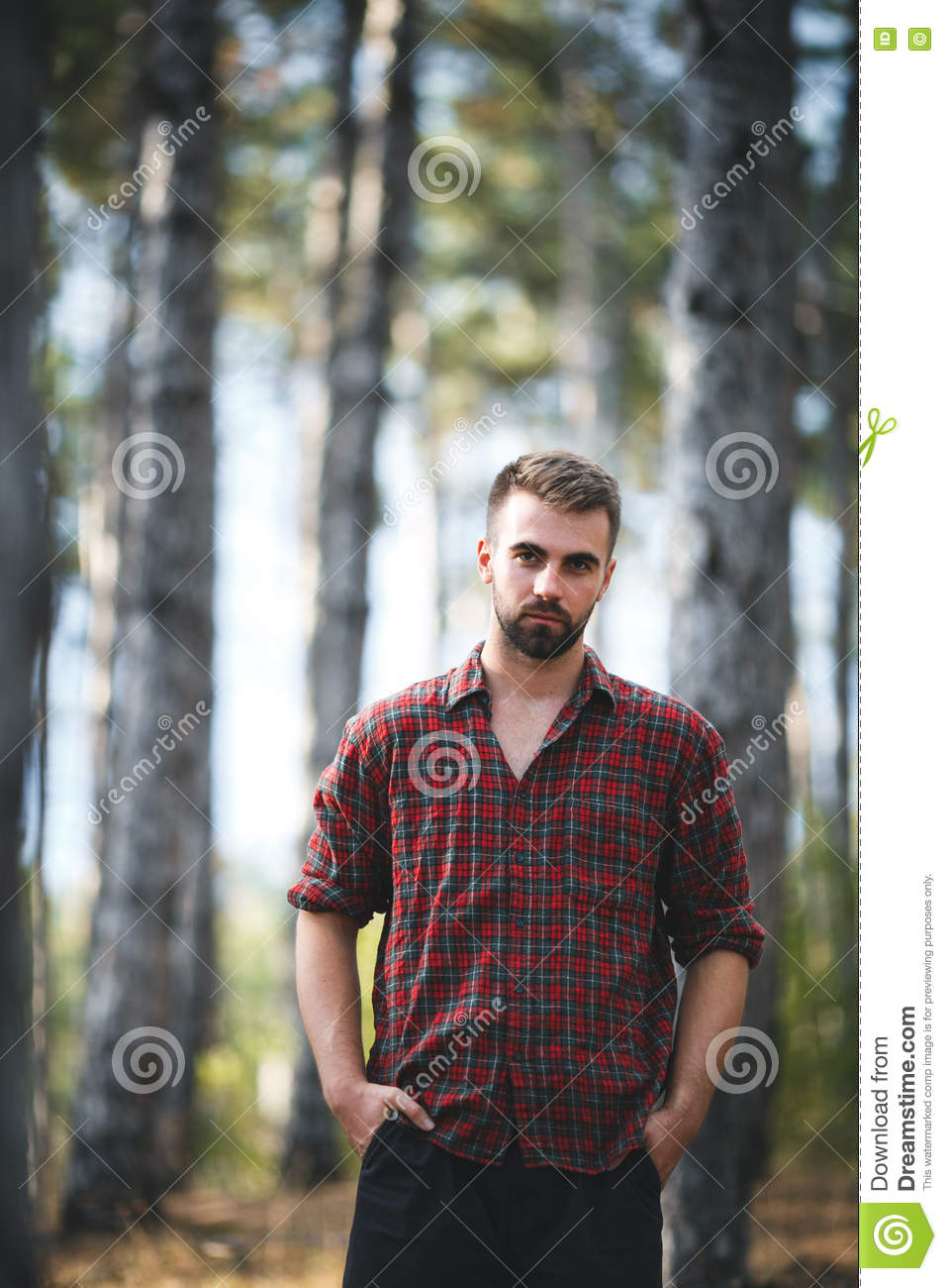 Handsome Fit Man Posing In Forest Wearing Checked Shirt
