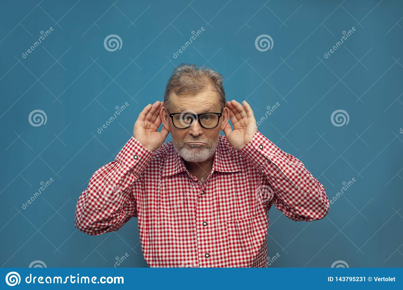 Handsome funny elderly man wearing smart casual style and eyeglasses