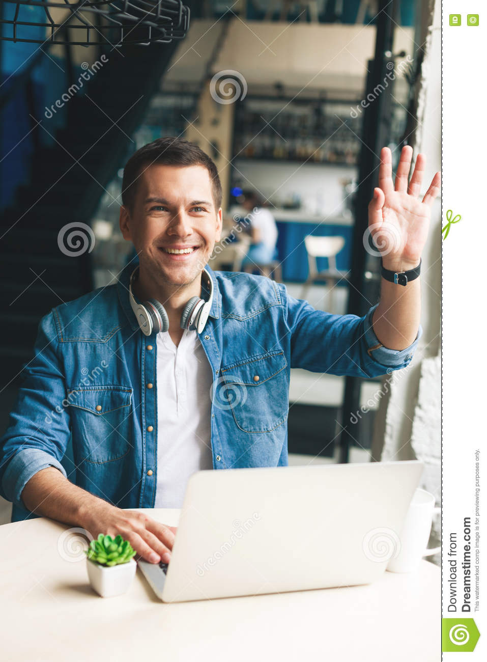 Handsome guy is greeting someone in cafeteria stock image image of handsome guy is greeting someone in cafeteria m4hsunfo