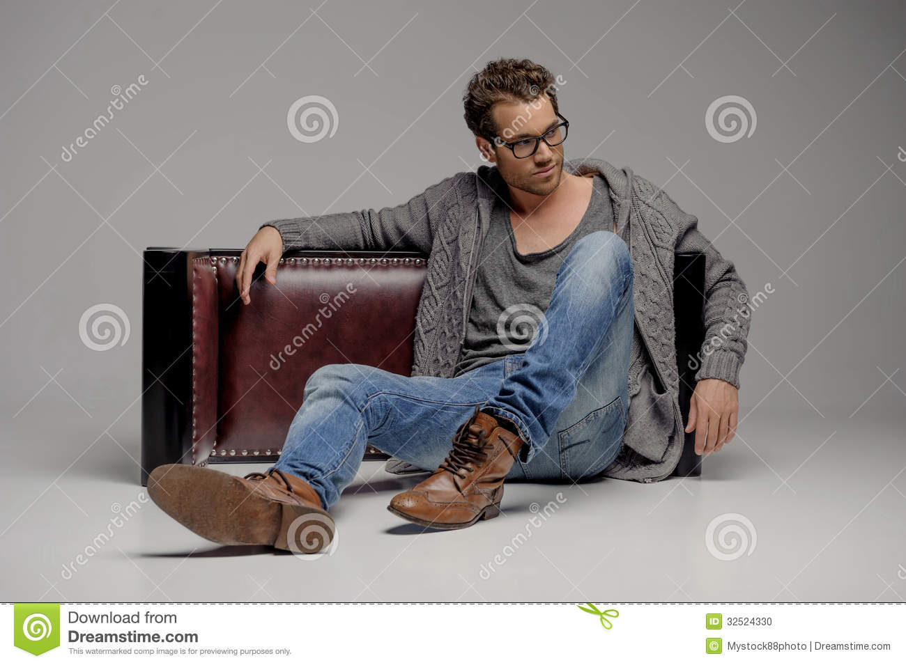 handsome guy handsome young men in glasses sitting on the floo stock photo image of brown. Black Bedroom Furniture Sets. Home Design Ideas