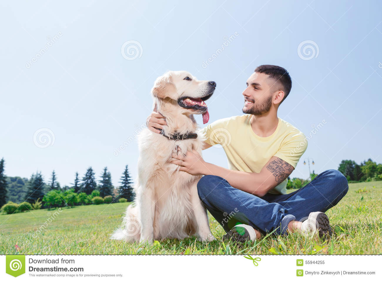 Man On Dog : Handsome guy with his dog stock photo image