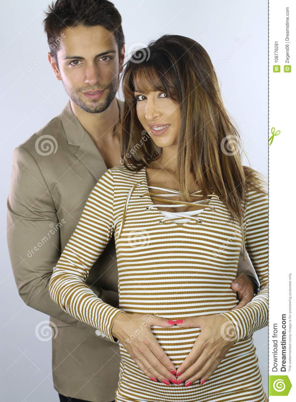 Handsome Guy Holding His Beautiful Pregnant Wife Stock