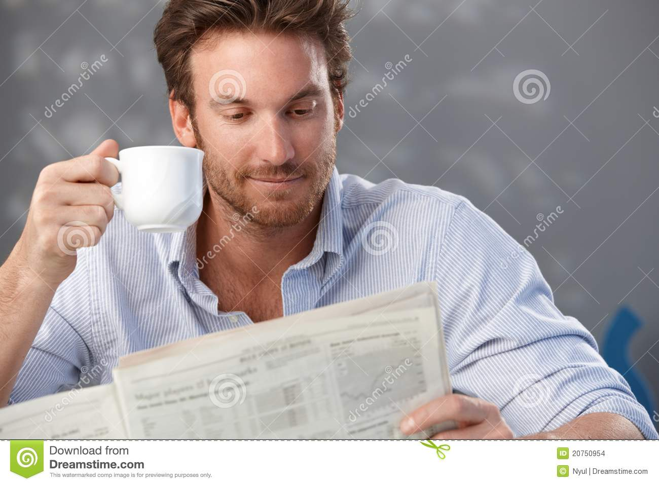 Handsome guy with newspaper