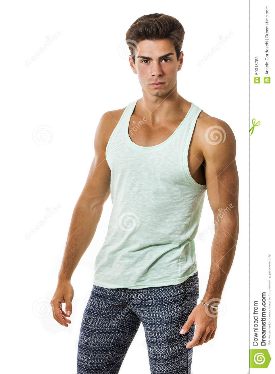fb950198ad6af Handsome guy in tank top and leggings on white background . Stylish hair