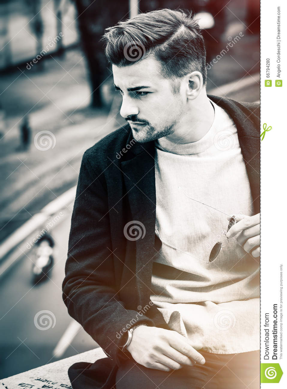 Handsome hairstyle young man city outdoors. Black and white