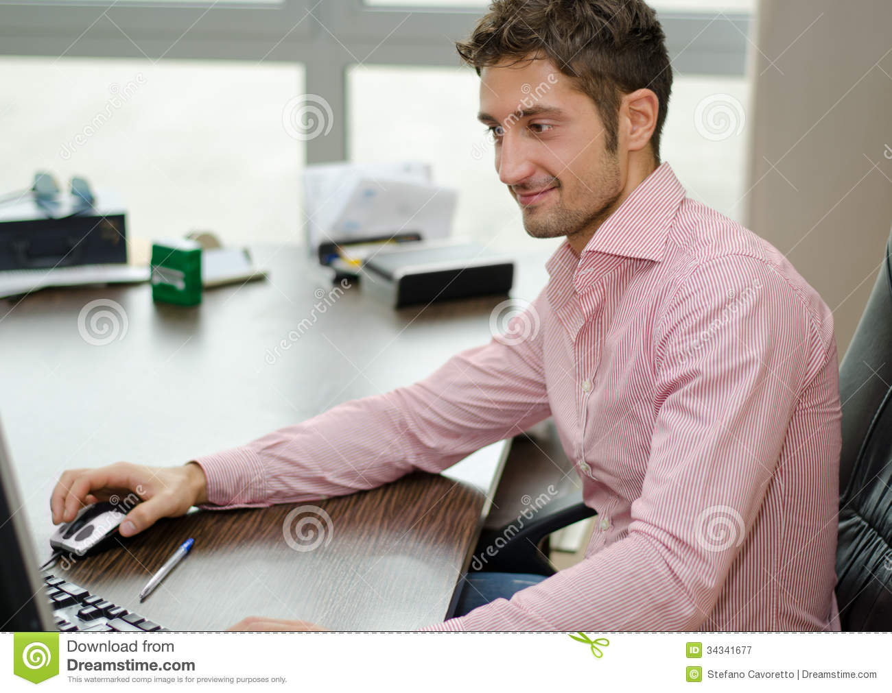 Office Worker Sitting At Desk, Doing Paperwork. Stock Photo ...