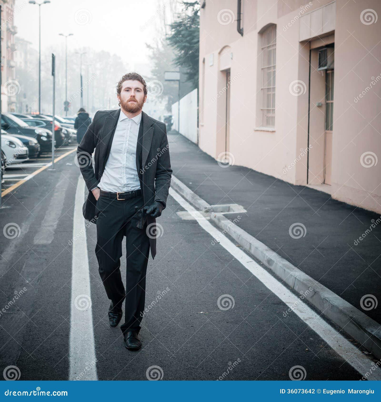 Handsome hipster elegant man in the city