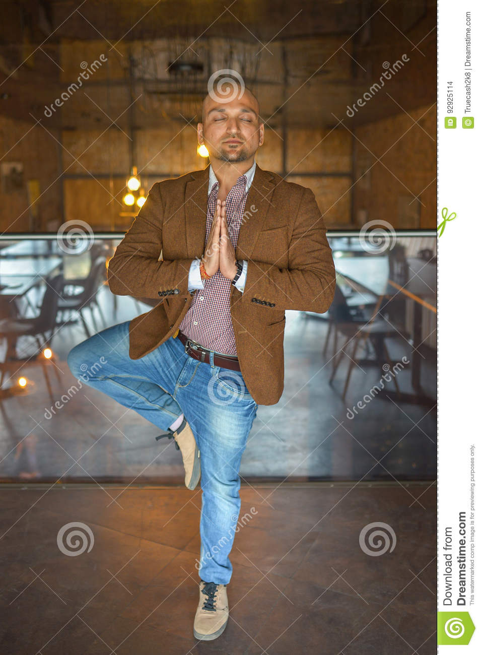 Handsome indian businessman weared in suit performing yoga or asana to relax, eyes closed