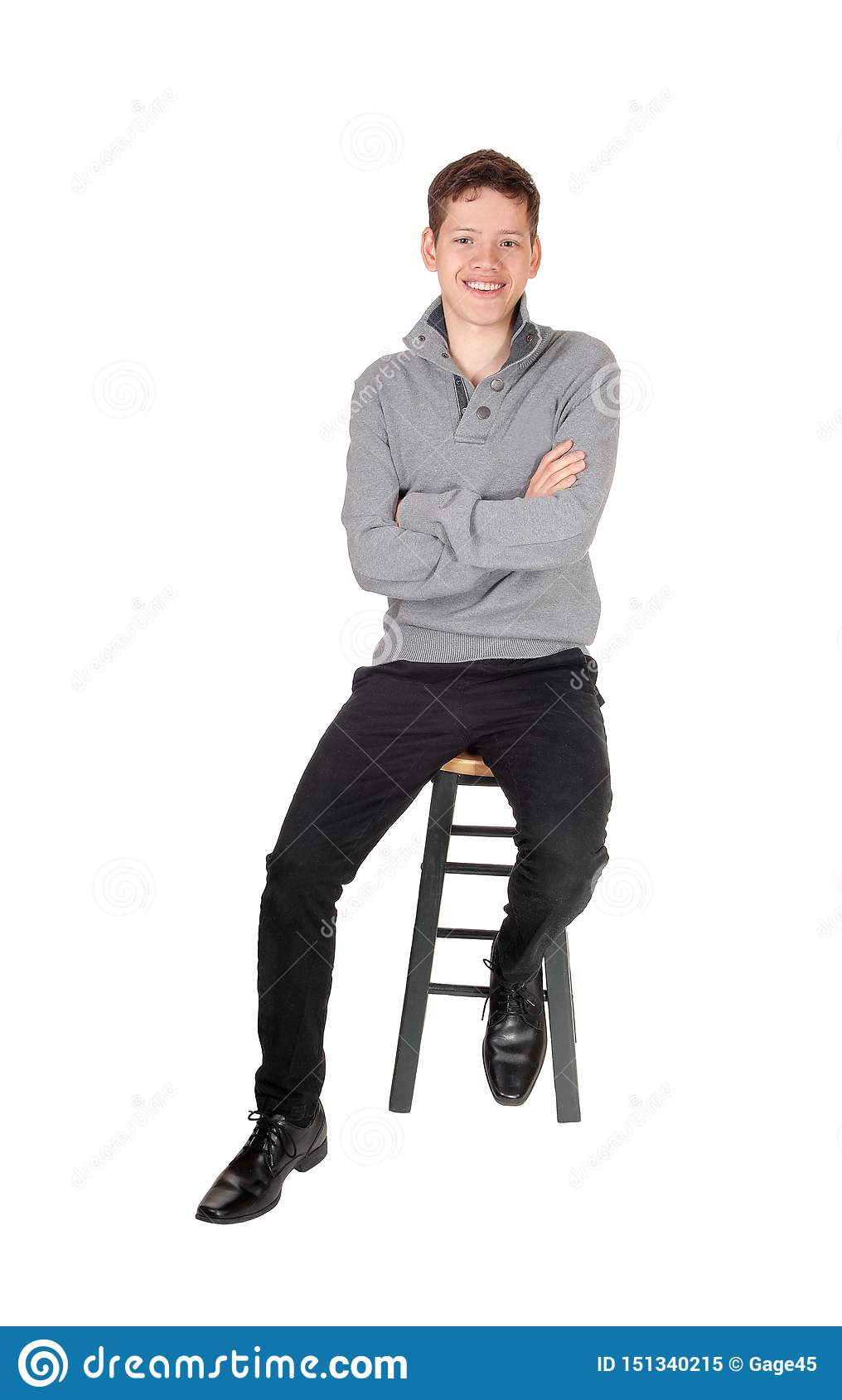 A Handsome Lovely Teenage Boy Sitting And Smiling Stock