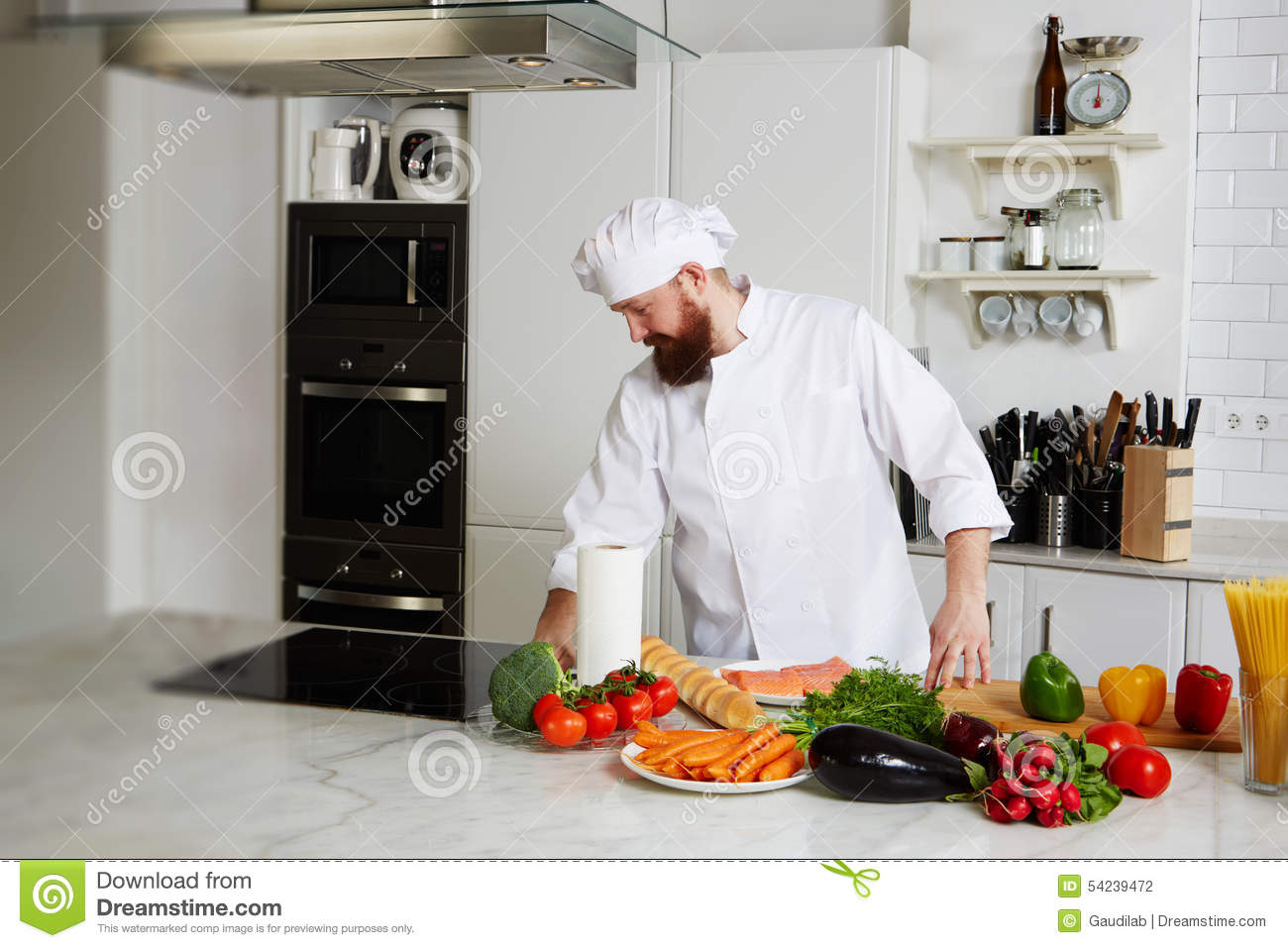Chef cooking fresh vegetable salad in his kitchen royalty for Fresh chef kitchen