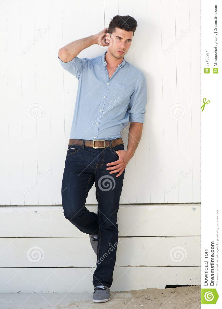 Top Handsome Male Fashion Model Standing Against White Wall Outdoors  JQ35