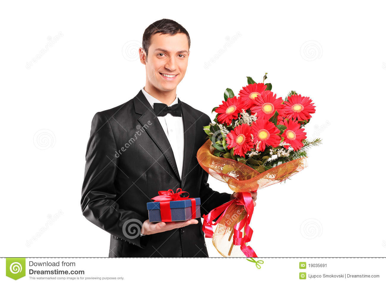 Handsome male holding a bouquet of flowers stock image image of handsome male holding a bouquet of flowers izmirmasajfo