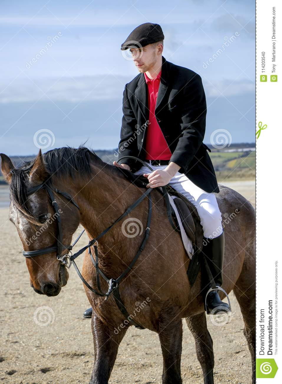 Handsome Male Horse Rider Riding Horse On Beach In Traditional Clothing Stock Photo Image Of Black Coastline 114203540