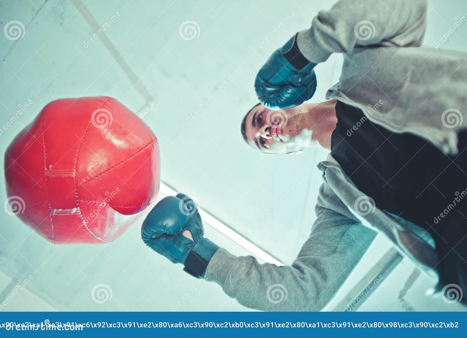 Handsome man boxer trains
