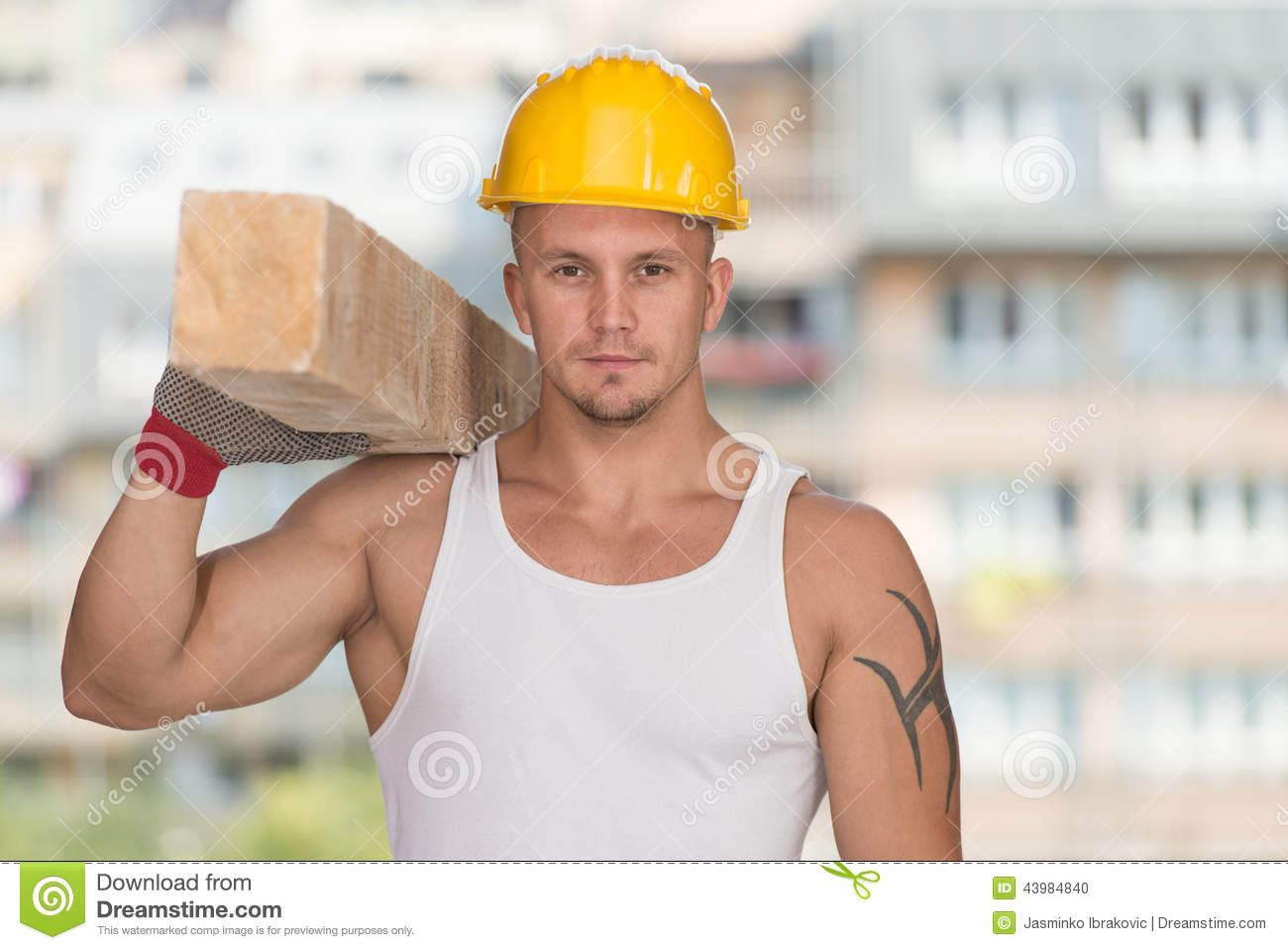 9e4cd4a1edb Handsome Man Carrying Wood Planks Stock Photo - Image of business ...