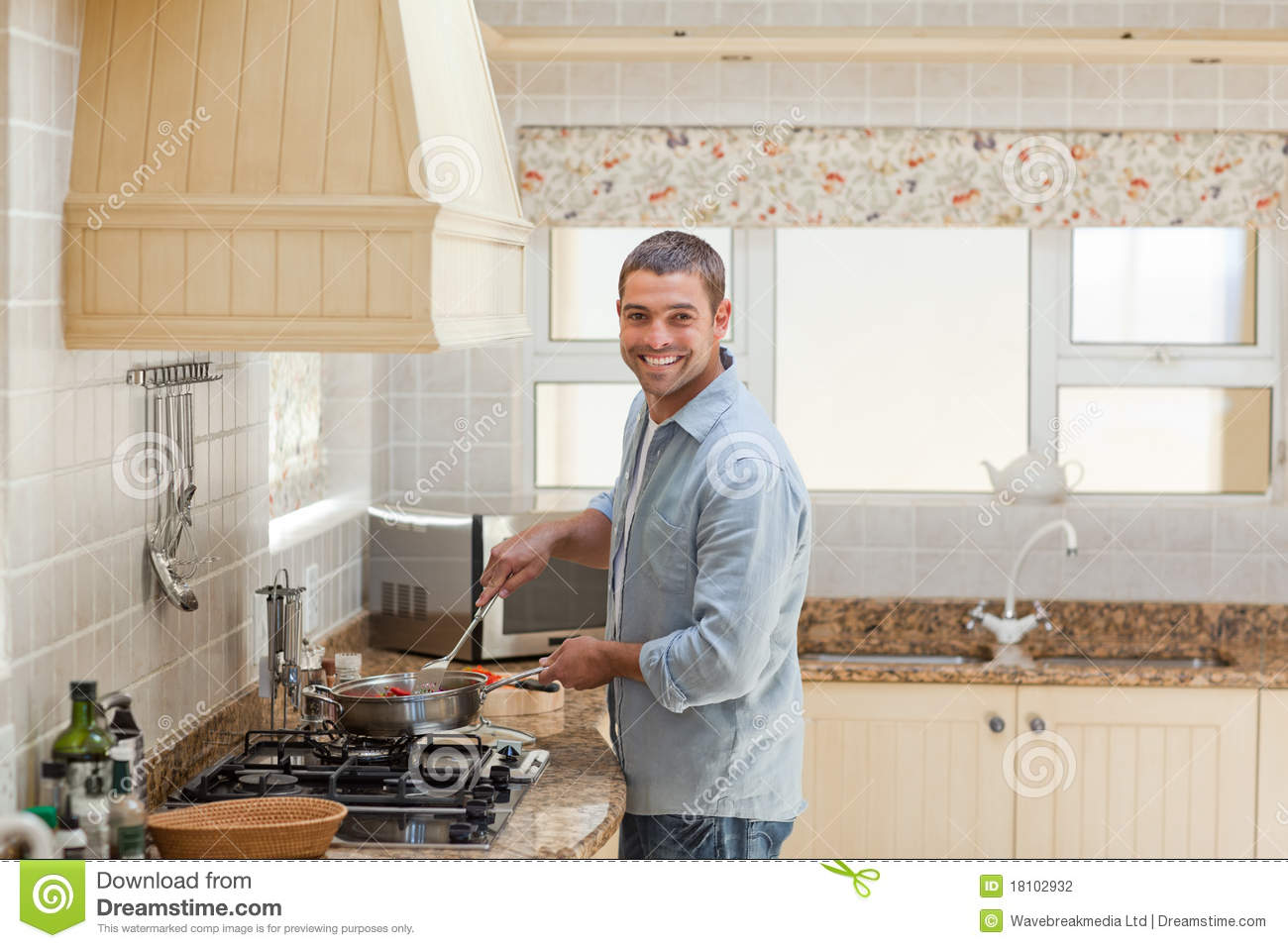 download handsome man cooking in the kitchen stock photo image of cheerful salt - Cooking In The Kitchen