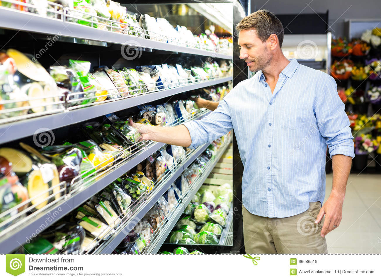 Handsome man doing grocery shopping